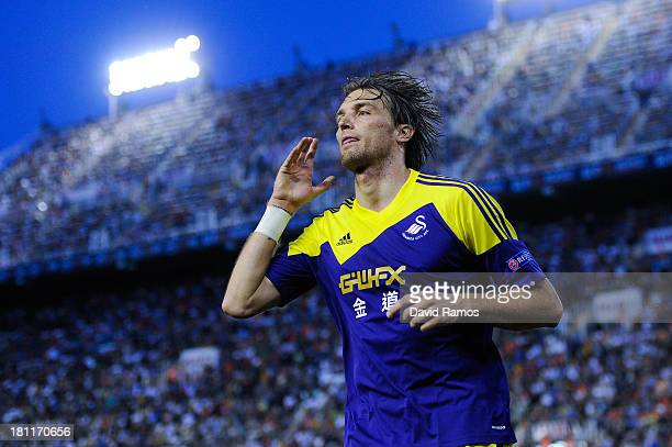 Michu of Swansea City celebrates after scoring his team's second goal the UEFA Europa League Group A match between Valencia CF and Swansea City at...