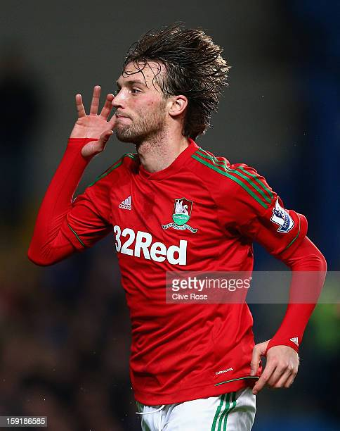 Michu of Swansea City celebrates scoring the opening goal during the Capital One Cup SemiFinal first leg match between Chelsea and Swansea City at...