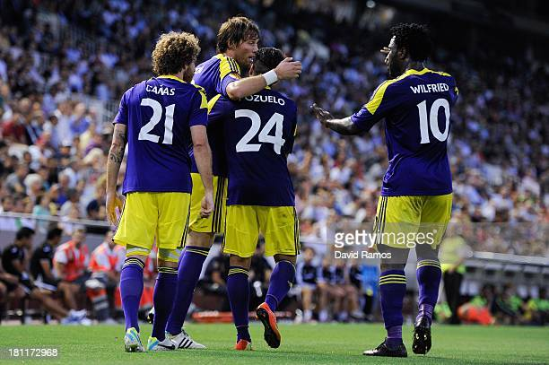 Michu of Swansea City celebrates with his teammates after scoring his team's second goal during the UEFA Europa League Group A match between Valencia...