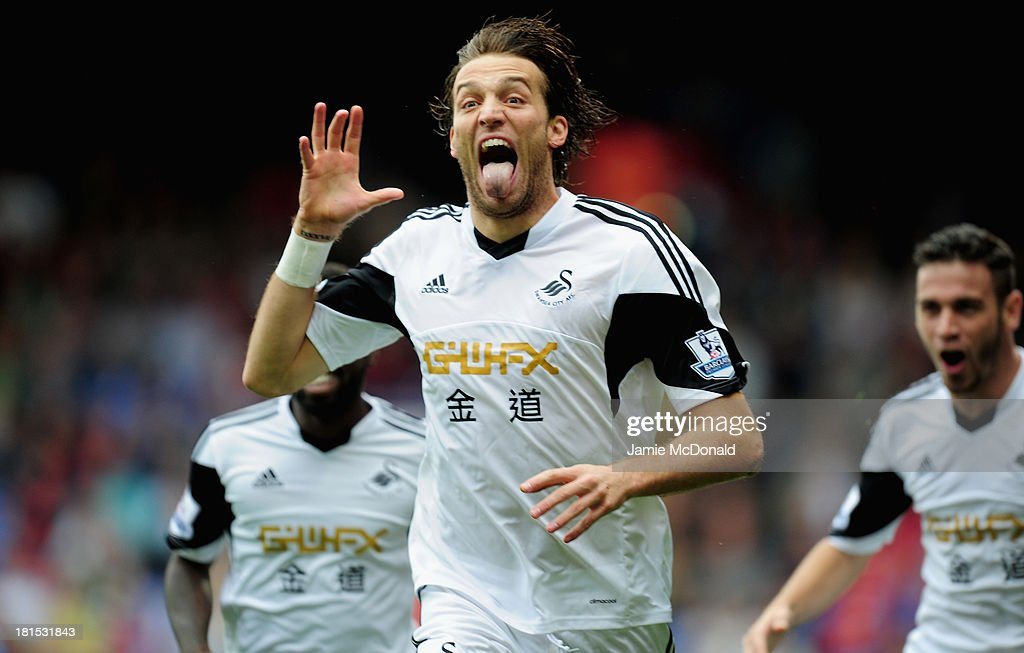Michu of Swansea City celebtates his goal during the Barclays Premier League match between Crystal Palace and Swansea City at Selhurst Park on September 22, 2013 in London, England.