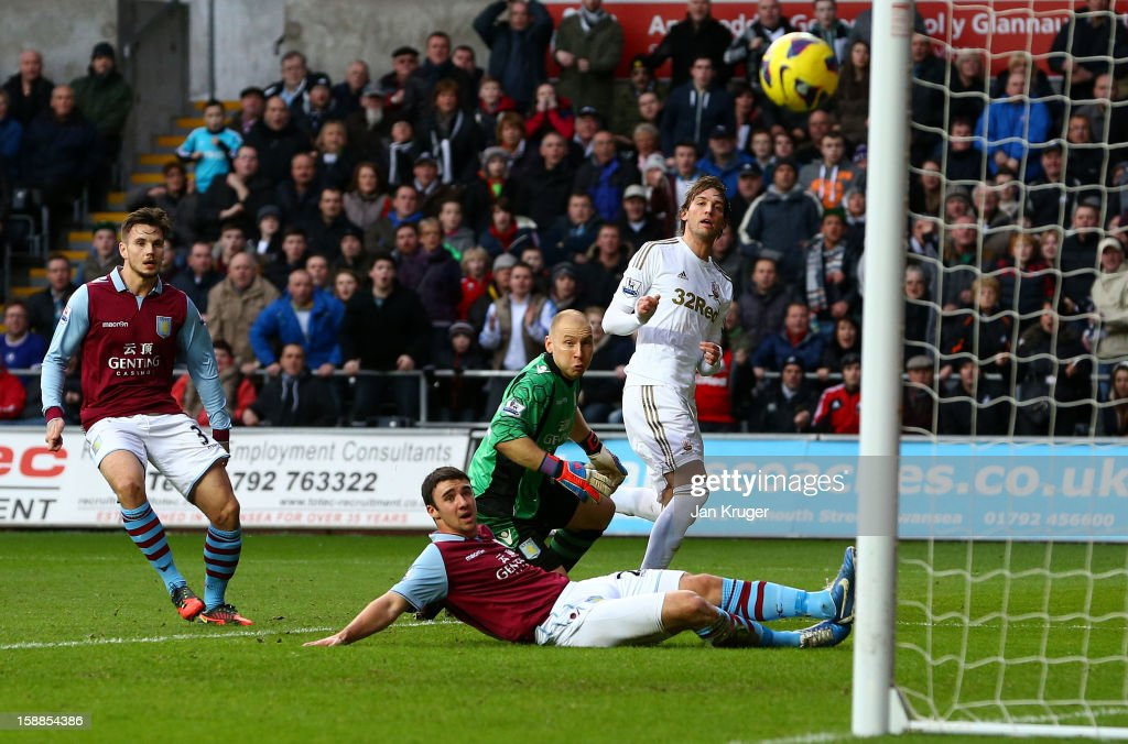Michu of Swansea City looks on as his shot at goal hits the upright after beating Brad Guzan, Goalkeeper of Aston Villa during the Barclays Premier League match between Swansea City and Aston Villa at the Liberty Stadium on January 1, 2013 in Swansea, Wales.