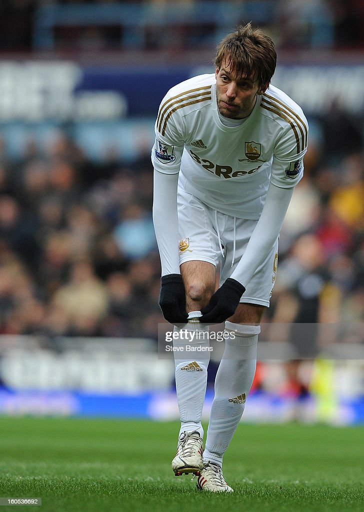 Michu of Swansea City pulls up his socks during the Barclays Premier League match between West Ham United and Swansea at the Boleyn Ground on February 2, 2013 in London, England.