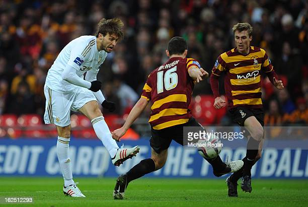 Michu of Swansea City scores their second goal during the Capital One Cup Final match between Bradford City and Swansea City at Wembley Stadium on...