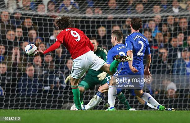 Michu of Swansea City shoots to score the opening goal during the Capital One Cup SemiFinal first leg match between Chelsea and Swansea City at...
