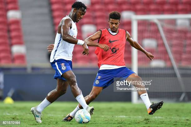 Michy Batshuayi and Jake ClarkeSalter of Chelsea FC competes during a Chelsea FC International Champions Cup training session at National Stadium on...