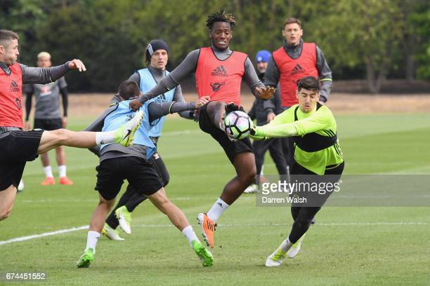 Michy Batshuayi and Thibaut Courtois of Chelsea during a training session at Chelsea Training Ground on April 28 2017 in Cobham England