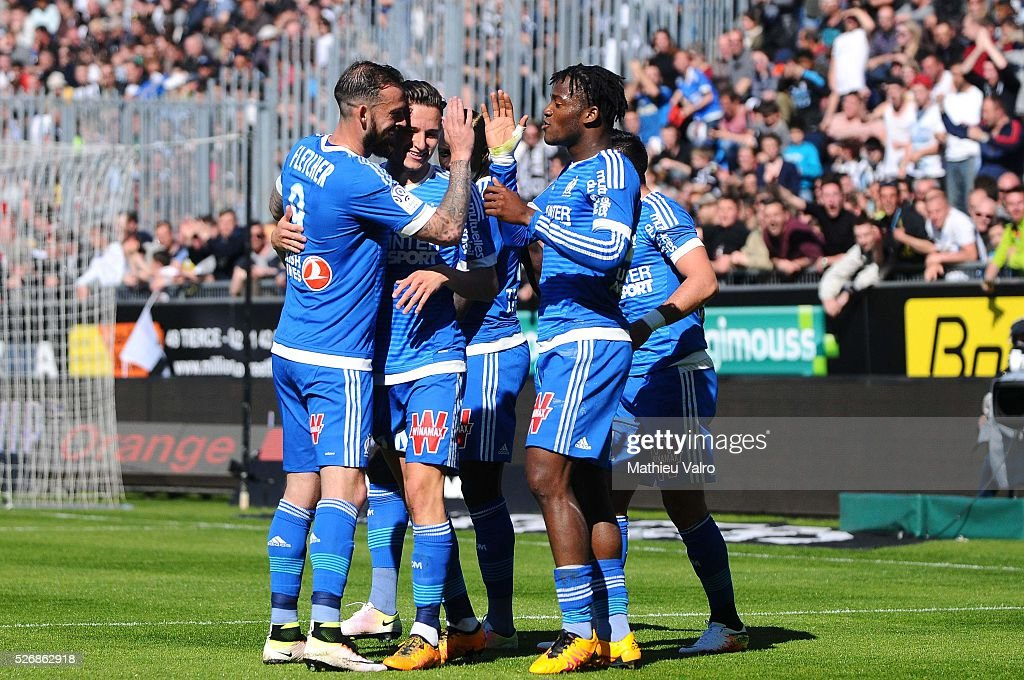 Michy Batshuayi celebrates with team mates during the French Ligue 1 match between Angers SCO and Olympique de Marseille on May 1, 2016 in Angers, France.