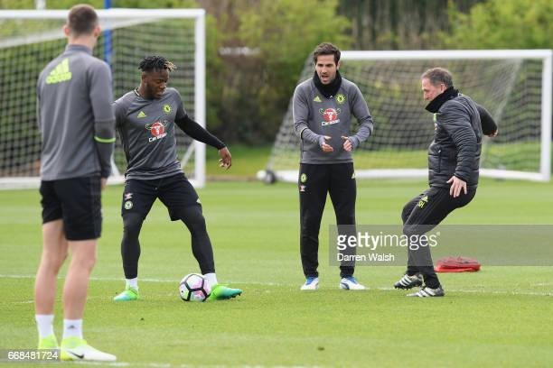 Michy Batshuayi Cesc Fabregas and Steve Holland of Chelsea during a training session at Chelsea Training Ground on April 14 2017 in Cobham England