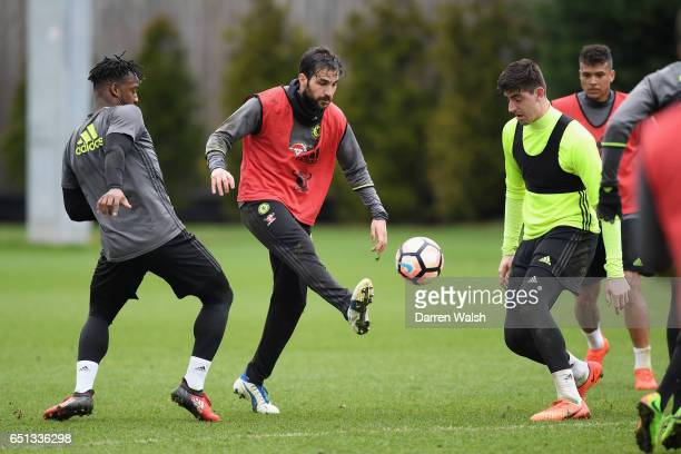 Michy Batshuayi Cesc Fabregas and Thibaut Courtois of Chelsea during a training session at Chelsea Training Ground on March 10 2017 in Cobham England