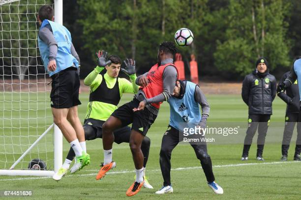 Michy Batshuayi Cesc Fabregas and Thibaut Courtois of Chelsea during a training session at Chelsea Training Ground on April 28 2017 in Cobham England