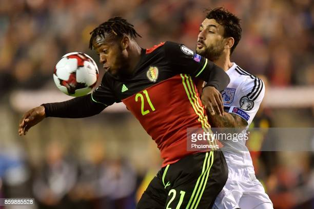 Michy Batshuayi forward of Belgium battles for the ball with Giorgos Merkis defender of Cyprus during the World Cup Qualifier Group H match between...