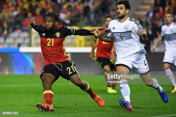 Michy Batshuayi forward of Belgium Giorgos Merkis defender of Cyprus during the World Cup Qualifier Group H match between Belgium and Cyprus at the...