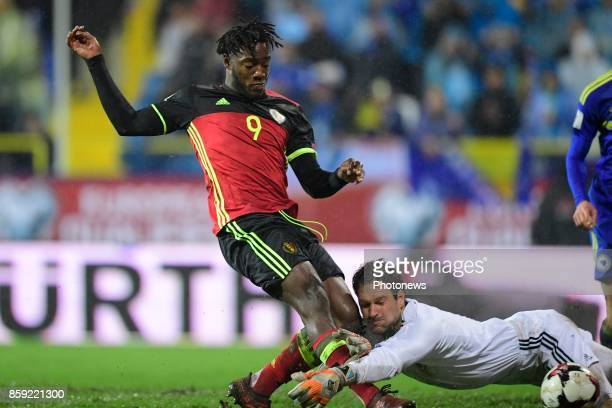 Michy Batshuayi forward of Belgium scoring the equalising goal in front of Asmir Begovic goalkeeper of Bosnia Herzegovina during the World Cup...