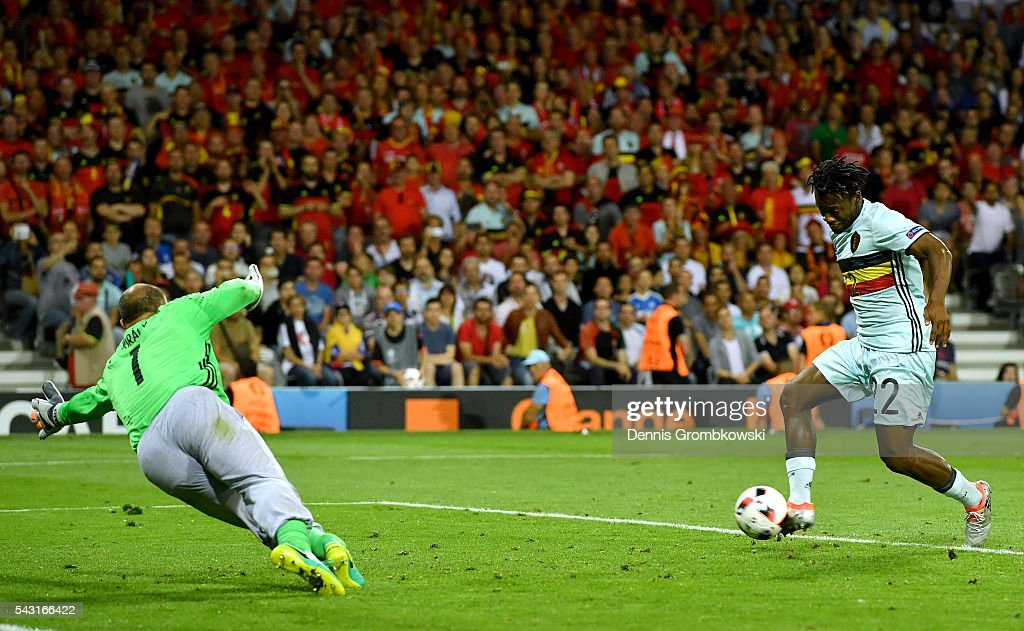 <a gi-track='captionPersonalityLinkClicked' href=/galleries/search?phrase=Michy+Batshuayi&family=editorial&specificpeople=8599446 ng-click='$event.stopPropagation()'>Michy Batshuayi</a> of Belgium scores his team's second goal past Gabor Kiraly of Hungary during the UEFA EURO 2016 round of 16 match between Hungary and Belgium at Stadium Municipal on June 26, 2016 in Toulouse, France.