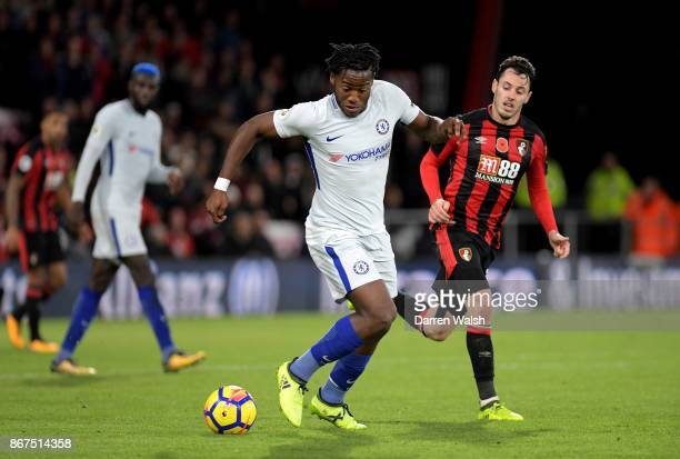 Michy Batshuayi of Chelsea and Adam Smith of AFC Bournemouth battle for possession during the Premier League match between AFC Bournemouth and...