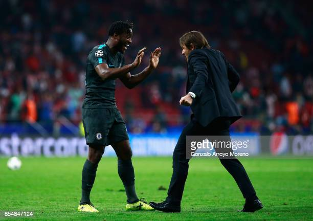 Michy Batshuayi of Chelsea and Antonio Conte Manager of Chelsea celebrate victory during the UEFA Champions League group C match between Atletico...