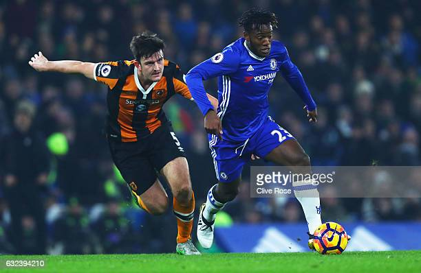 Michy Batshuayi of Chelsea and Harry Maguire of Hull City compete for the ball during the Premier League match between Chelsea and Hull City at...