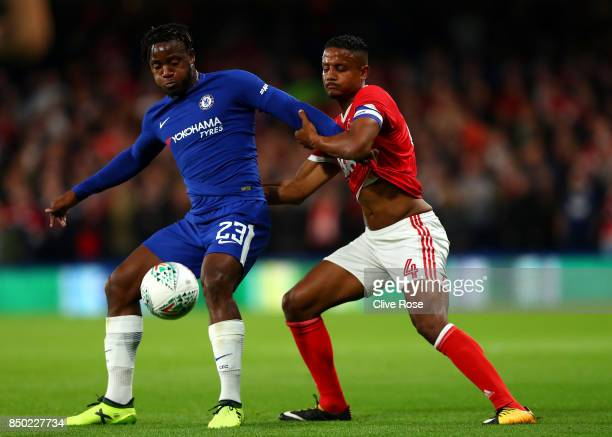 Michy Batshuayi of Chelsea and Michael Mancienne of Nottingham Forest battle for possession during the Carabao Cup Third Round match between Chelsea...