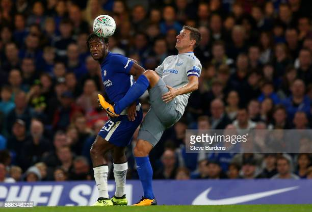 Michy Batshuayi of Chelsea and Phil Jagielka of Everton in action during the Carabao Cup Fourth Round match between Chelsea and Everton at Stamford...