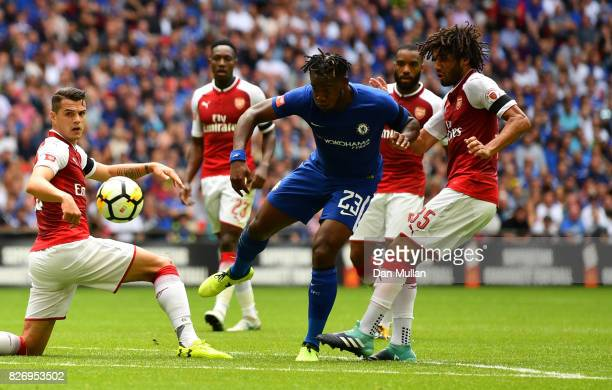 Michy Batshuayi of Chelsea attempts to get past Granit Xhaka of Arsenal and Mohamed Elneny of Arsenal during the The FA Community Shield final...