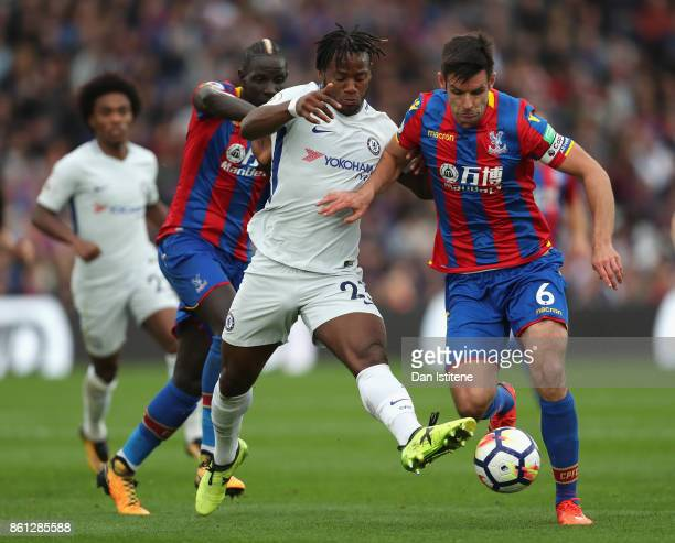 Michy Batshuayi of Chelsea battles for possession with Mamadou Sakho of Crystal Palace and Scott Dann of Crystal Palace during the Premier League...