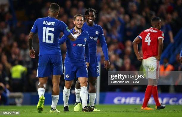 Michy Batshuayi of Chelsea celebrates after he scores to make it 50 with Eden Hazard and Kenedy of Chelsea as a dejected Michael Mancienne of...