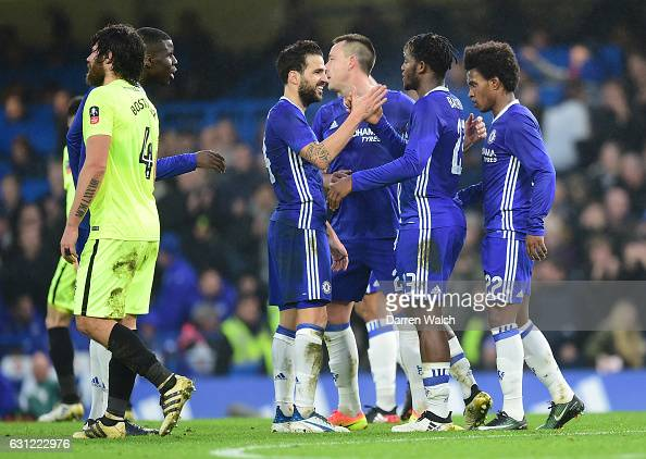 Michy Batshuayi of Chelsea celebrates scoring his sides second goal with team mates during The Emirates FA Cup Third Round match between Chelsea and...