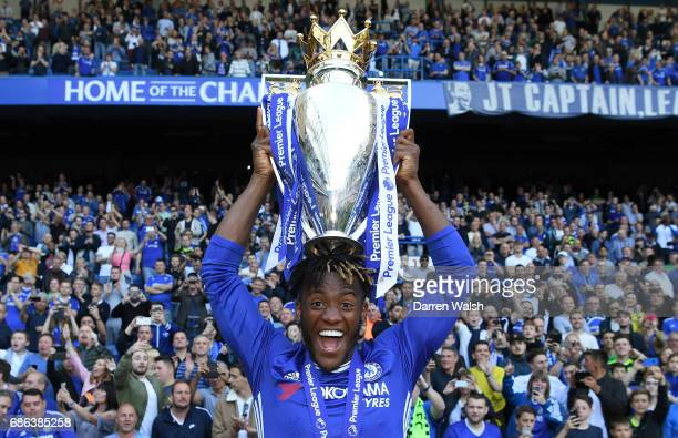 Michy Batshuayi of Chelsea celebrates with the Premier League Trophy after the Premier League match between Chelsea and Sunderland at Stamford Bridge...
