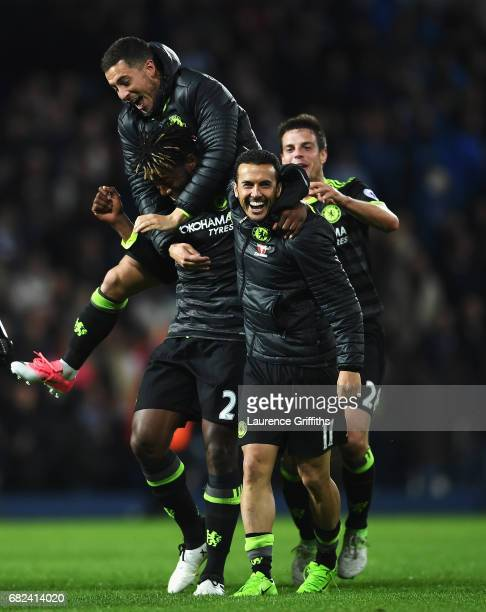 Michy Batshuayi of Chelsea Eden Hazard of Chelsea and Pedro of Chelsea celebrate winning the league after the Premier League match between West...