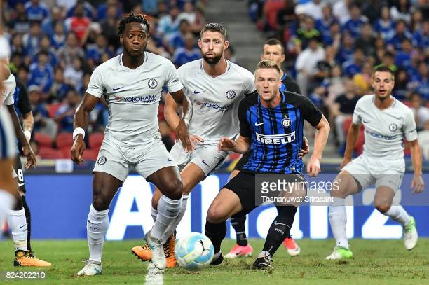 Michy Batshuayi of Chelsea FC and Milan Skriniar of FC Interernazionale competes for the ball during the International Champions Cup match between FC...