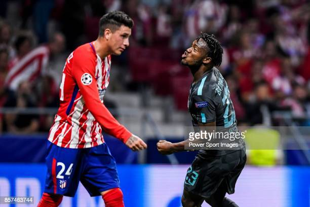 Michy Batshuayi of Chelsea FC celebrates as Jose Maria Gimenez de Vargas of Atletico de Madrid walks by during the UEFA Champions League 201718 match...