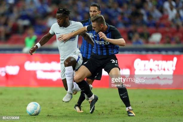 Michy Batshuayi of Chelsea FC competes for the ball with Milan Skriniar of FC Internazionale during the International Champions Cup match between FC...