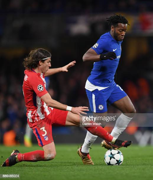 Michy Batshuayi of Chelsea is challenged by Filipe Luis of Atletico Madrid during the UEFA Champions League group C match between Chelsea FC and...