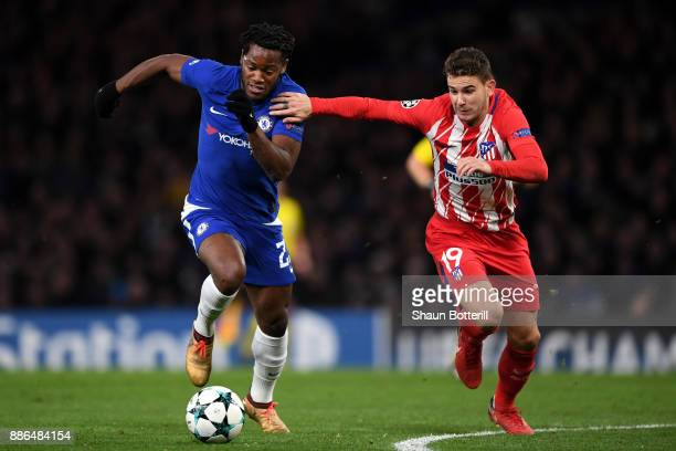 Michy Batshuayi of Chelsea is challenged by Lucas Hernandez of Atletico Madrid during the UEFA Champions League group C match between Chelsea FC and...