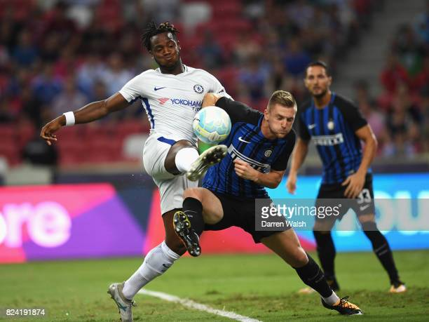 Michy Batshuayi of Chelsea is challenged by Milan Skriniar of Internazionale during the International Champions Cup match between FC Internazionale...