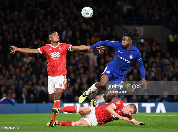 Michy Batshuayi of Chelsea is tackled by Michael Mancienne of Nottingham Forest and Joe Worrall of Nottingham Forest during the Carabao Cup Third...