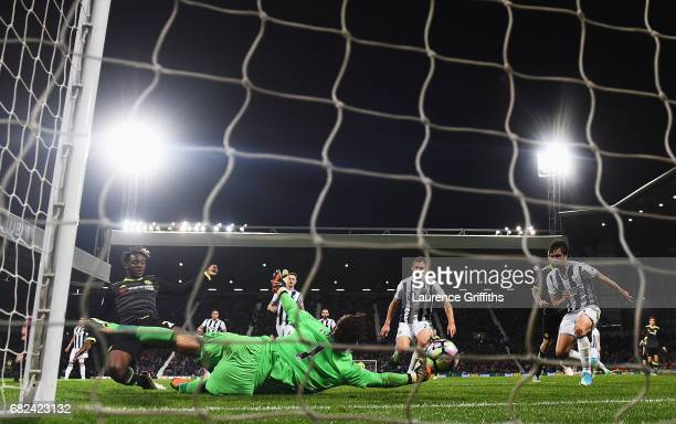 Michy Batshuayi of Chelsea scores his sides first goal past Ben Foster of West Bromwich Albion during the Premier League match between West Bromwich...
