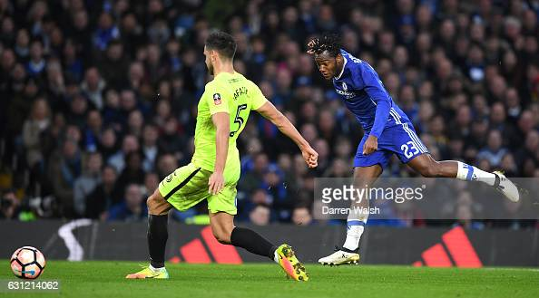 Michy Batshuayi of Chelsea shoots while Ryan Tafazolli of Peterborough United attempts to block during The Emirates FA Cup Third Round match between...