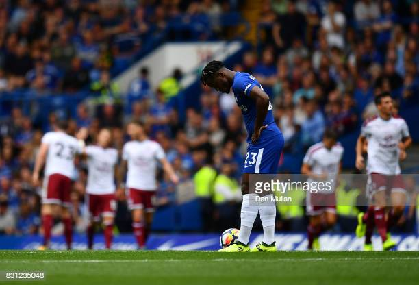 Michy Batshuayi of Chelsea stands dejected after his side concede their first goal during the Premier League match between Chelsea and Burnley at...