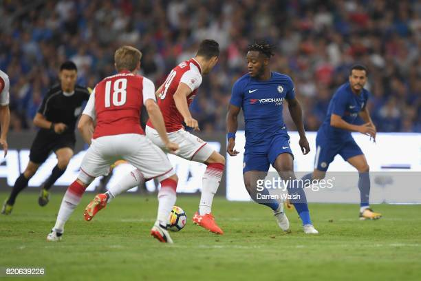 Michy Batshuayi of Chelsea takes on Granit Xhaka of Arsenal during the PreSeason Friendly match between Arsenal FC and Chelsea FC at Birds Nest on...