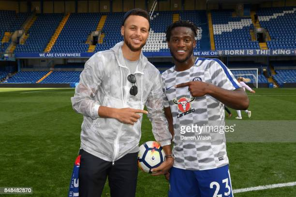 Michy Batshuayi of Chelsea with basketball player Steph Curry after the Premier League match between Chelsea and Arsenal at Stamford Bridge on...