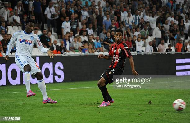 Michy Batshuayi of Marseille in action during the French Ligue 1 match between Olympique de Marseille and OGC Nice at Stade Velodrome on August 29...