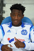Michy Batshuayi of Marseille is seen on the bench prior to the French Ligue 1 match between Olympique de Marseille and OGC Nice at Stade Velodrome on...