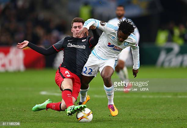 Michy Batshuayi of Marseille is tackled by Aymeric Laporte of Athletic Club Bilbao during the UEFA Europa League Round of 32 match between Marseille...