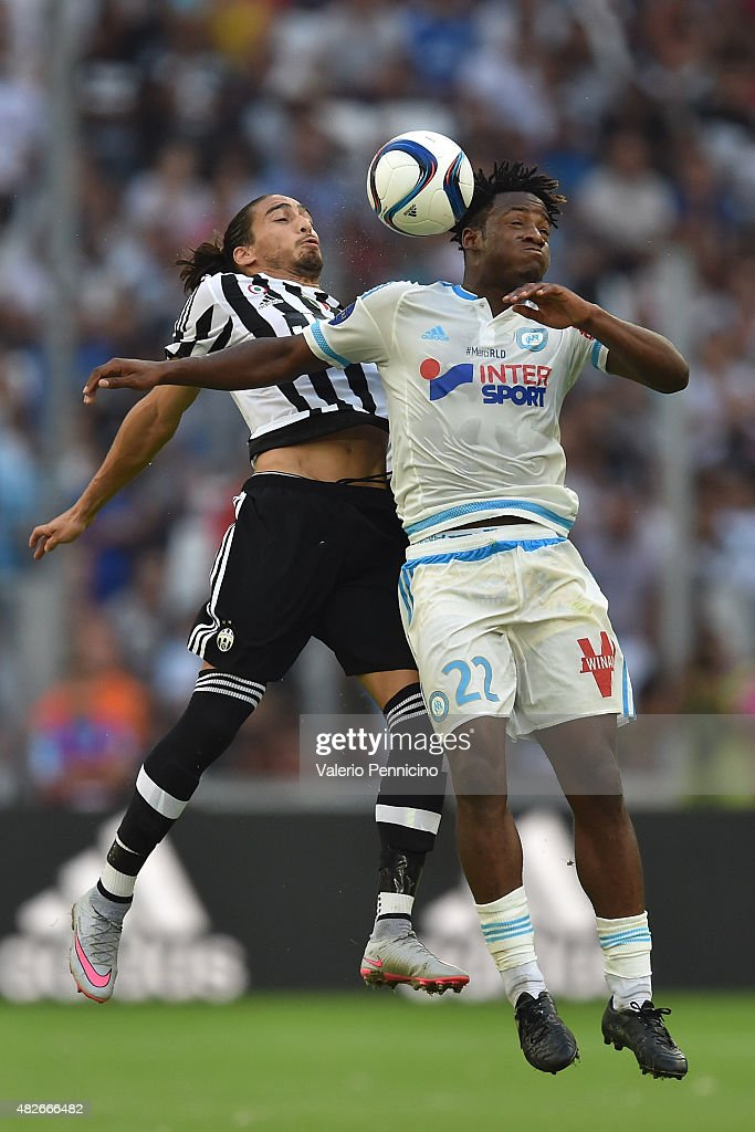 <a gi-track='captionPersonalityLinkClicked' href=/galleries/search?phrase=Michy+Batshuayi&family=editorial&specificpeople=8599446 ng-click='$event.stopPropagation()'>Michy Batshuayi</a> (R) of Olympique de Marseille goes up with Martin Caceres of Juventus FC during the preseason friendly match between Olympique de Marseille and Juventus FC at Stade Velodrome on August 1, 2015 in Marseille, France.