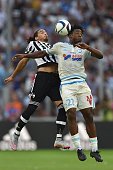 Michy Batshuayi of Olympique de Marseille goes up with Martin Caceres of Juventus FC during the preseason friendly match between Olympique de...