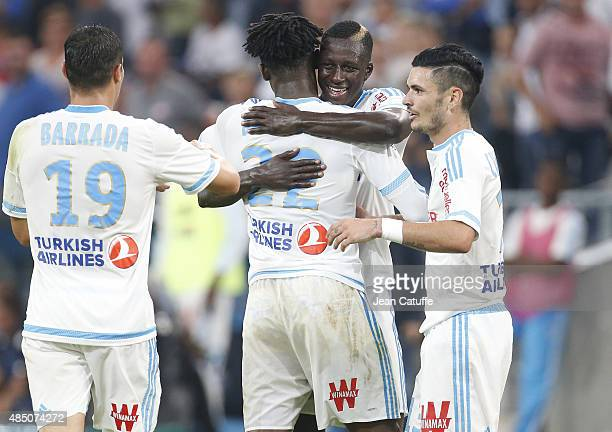 Michy Batshuayi of OM celebrates his goal with Benjamin Mendy and Remy Cabella of OM during the French Ligue 1 match between Olympique de Marseille...