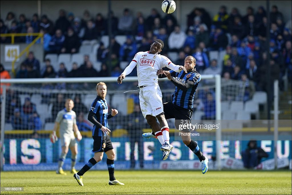 Michy Batshuayi of Standard and Vadis Odjidja Ofoe of Club Brugge KV in an airduel during the Jupiler League match between Club Brugge and Standard de Liege on April 01, 2013 in the Jan Breydel Stadium in Brugge, Belgium.