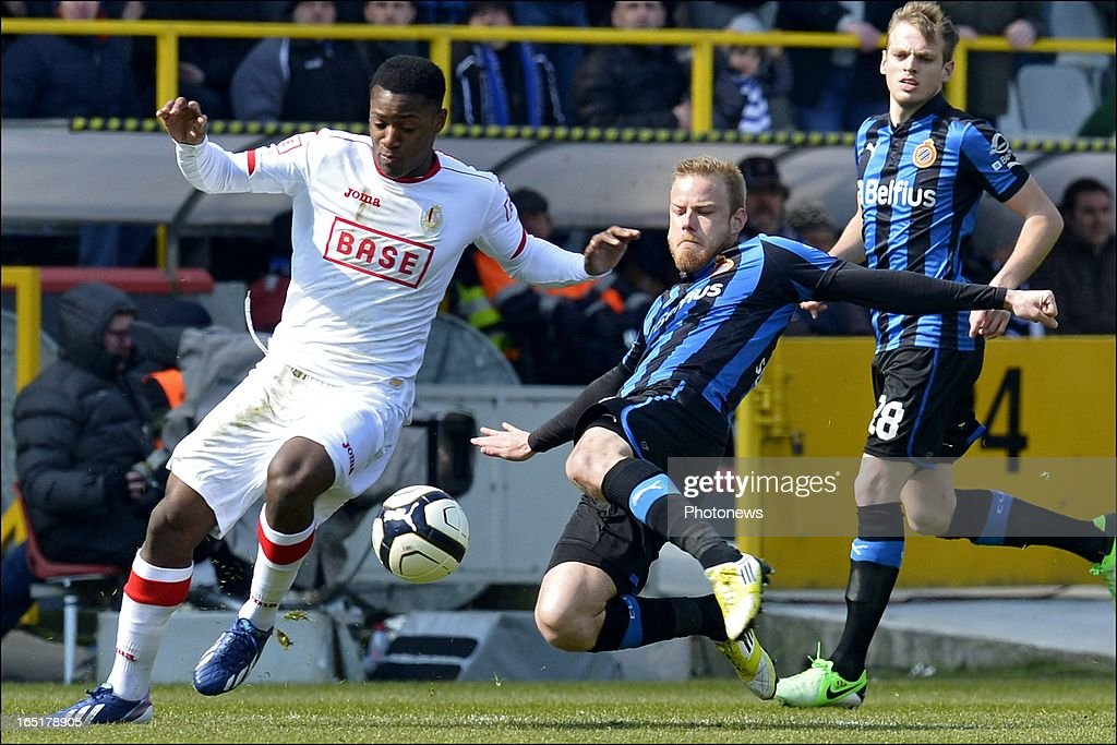 Michy Batshuayi of Standard battles for the ball with Frederik Stenman of Club Brugge KV during the Jupiler League match between Club Brugge and Standard de Liege , in the Jan Breydel Stadium on April 01, 2013 in Brugge, Belgium.