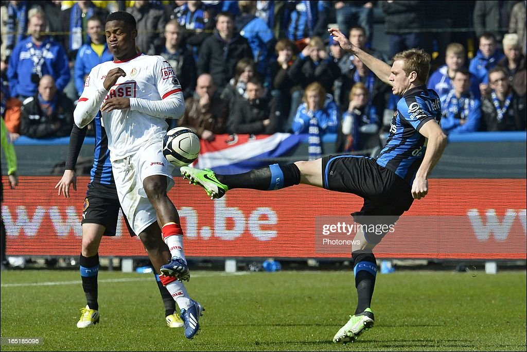 Michy Batshuayi of Standard battles for the ball with Laurens De Bock of Club Brugge KV during the Jupiler League match between Club Brugge and Standard de Liege on April 01, 2013 in the Jan Breydel Stadium in Brugge, Belgium.